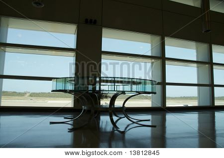 Glass table  in the waiting lounge in airport