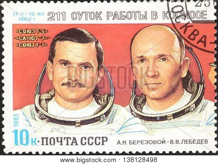 MOSCOW RUSSIA - DECEMBER 2015: a post stamp printed in the USSR shows a portrait of spacemen A. N. Berezovoi and V. V. Lebedev devoted to Space Research by