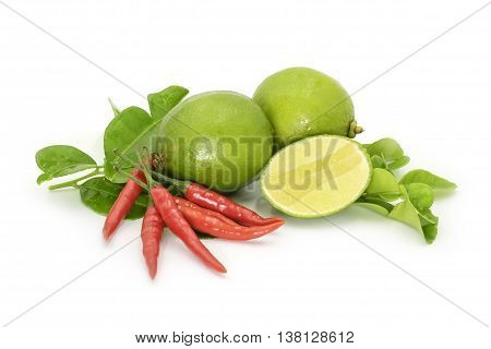 Kaffir Leaves, Limes And Red Thai Chilli On White Backround. Herb And Spicy Ingredients For Making T