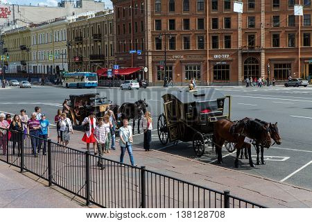Saint Petersburg, Russia - 10 July : street in Saint Petersburg by St. Isaac's Cathedral , people go, tourists are horses with carriages the days of military glory of Russia on 10 July, 2016.