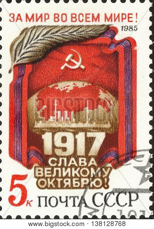 MOSCOW RUSSIA - DECEMBER 2015: a post stamp printed in the USSR and devoted to The 68th Anniversary of October Revolution circa 1985