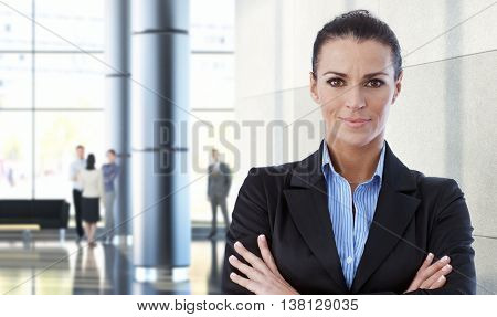 Mid-adult caucasian businesswoman indoors in office building.