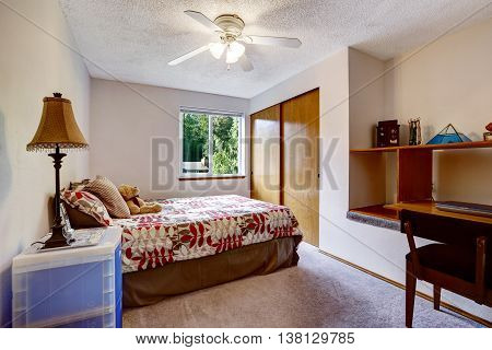 Simplistic And Cozy Bedroom Interior With Colorful Bedding And Built-in Wardrobe