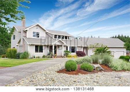 Large Beige House With White Trim, And Well Kept Lawn