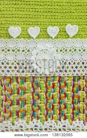 Handmade crochet pattern knitting sewing. Homemade stitch colorful backdrop embroidery with flower lace hearts. Background for sketchbook notebook. Place for text
