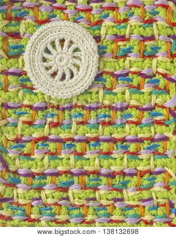 Handmade crochet pattern knitting sewing. Homemade stitch colorful backdrop embroidery with flower. Background for sketchbook notebook. Place for text