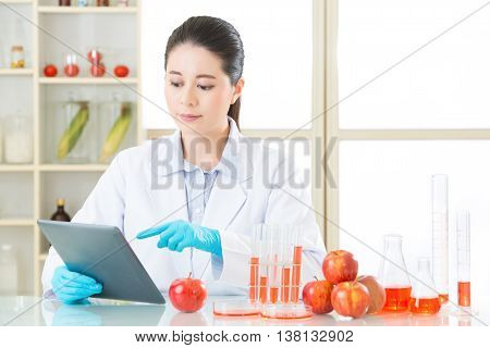 Asian Female Scientist Research For Genetic Modification Food