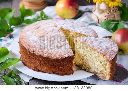 apple pie on table closeup on a wooden background