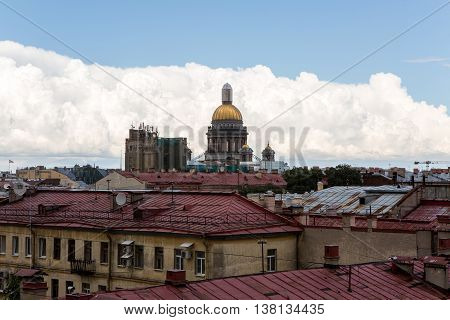 Saint Petersburg, Russia - 10 July : St. Isaac Cathedral Built in 1818-1858 years by architect Auguste Montferrand. Roofs of the old houses, the days of military glory of Russia on 10 July, 2016.