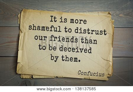 Ancient chinese philosopher Confucius quote on old paper background.  It is more shameful to distrust our friends than to be deceived by them.