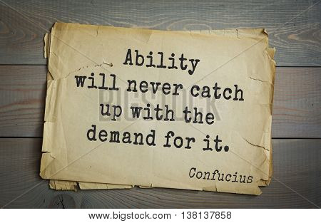 Ancient chinese philosopher Confucius quote on old paper background. Ability will never catch up with the demand for it.