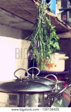 Herbs hung in the kitchen utility room - vintage retro color tone