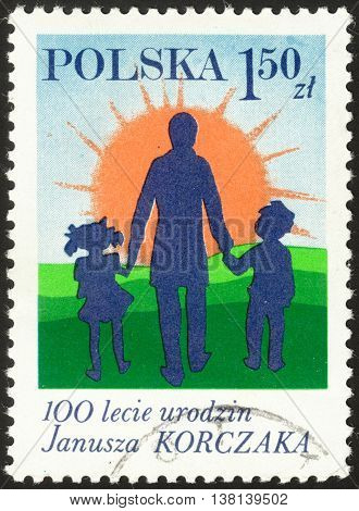 MOSCOW RUSSIA - DECEMBER 2015: a post stamp printed in POLAND shows Doctor Korczak and Children devoted to the 100th Anniversary of the Birth of Janusz Korczak circa 1978