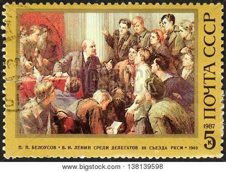MOSCOW RUSSIA - DECEMBER 2015: post stamp printed in the USSR shows Lenin snd Delegates at the 3rd Congress of the Soviet Communist League series
