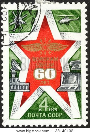 MOSCOW RUSSIA - DECEMBER 2015: a post stamp printed in the USSR shows a red star and devoted to the 60th Anniversary of Signal Corps of the USSR circa 1979