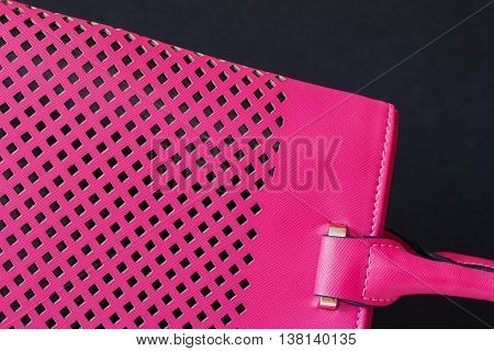 Background of the purple handbags with trendy perforated from a genuine leather