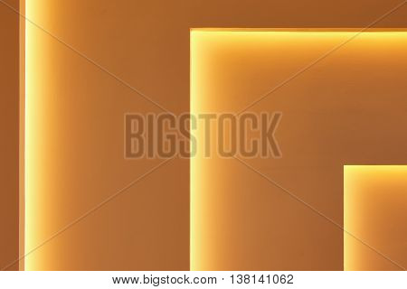 Yellow wall with gradient light decoration in angle. Horizontal