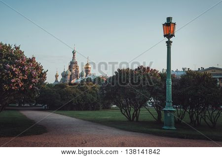 SAINT-PETERSBURG RUSSIA - May 22: Summer view on historical Russian monument Church of the Resurrection of Christ Saviour on Spilled Blood on lilac bloom the Field of Mars Marsovo Pole in centre Saint Petersburg Russia May 22 2016