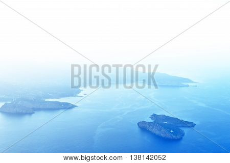 View outside of an airplane window to Ibiza Island. Sunset scene with copy space.