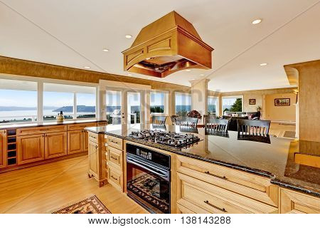 Luxury Kitchen With Water View, Island And Sink.