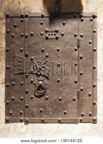 Medieval wrought iron door in a sand stone wall Germany 2016