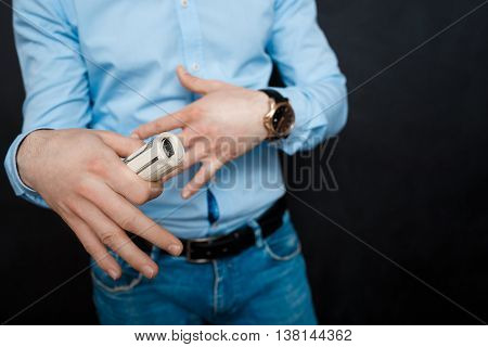 close up shop man holding dollars. suited. watch