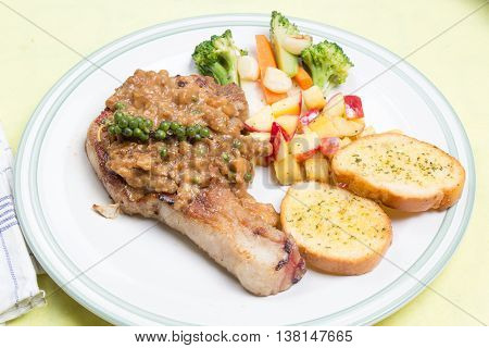 Pork chop steak / cooking porkchop steak concept