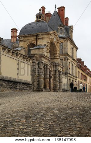 FONTAINEBLEAU, FRANCE - MAY 16, 2015: Initially Gate of the Dauphin was the main gate of the palace of Fontainebleau.