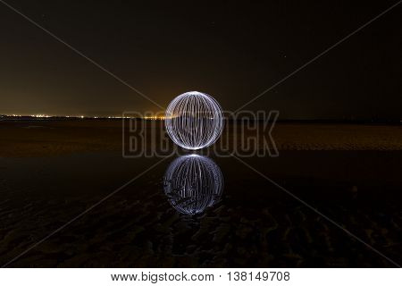 White Light Painted Orb spin with reflection in water