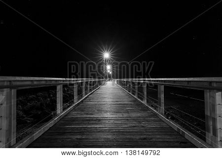Old Wellington Point jetty and night lights, Black and White