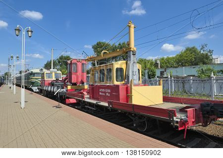 MOSCOW, RUSSIA - JUNE 23, 2016: Museum of Railway Transport motor-trolley cargo mounting AGMu-5256 it is designed to serve the railway line equipped with a crane hoist beam built in 1965