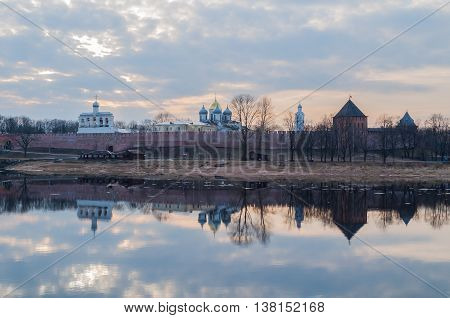 Architecture panoramic landscape view of Novgorod Kremlin fortress and St Sophia cathedral on the bank of the Volkhov river in spring sunset evening