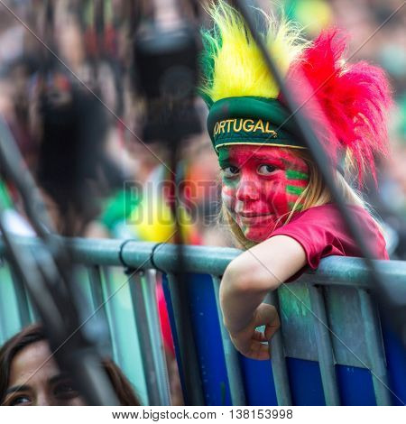 PORTO, PORTUGAL - JUL 10, 2016: Portuguese fans during the football match Portugal - France final of the European championship 2016, in Liberdade Square at city center of Porto.