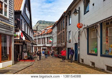 STAVANGER, NORWAY - JULY 13, 2015: Unidentified people walking on the sidewalk of a shopping street in the city centre. Stavanger is one of most famous cruise travel destinations in Europe.