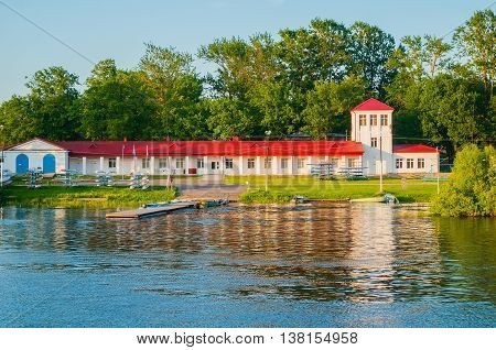 VELIKY NOVGOROD RUSSIA -MAY 29 2016. Architecture summer view of Boat station building and boats near the bank of the Volkhov river in Veliky Novgorod Russia