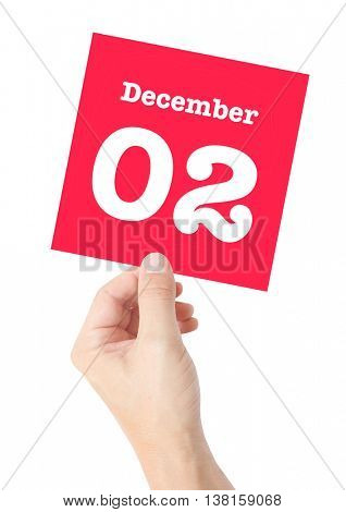 December 2 written on a card held by a hand