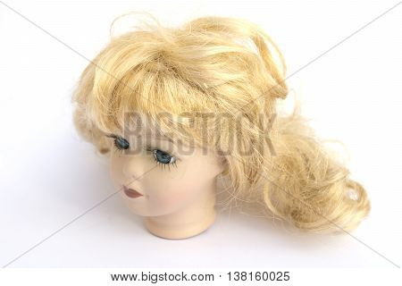 Blonde Girl Doll Head on White Background