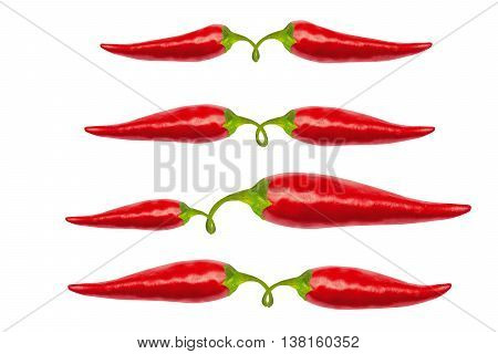 Red hot chili peppers with clipping path isolated on white. Red hot chili peppers with work path. Spicy chilli peppers.