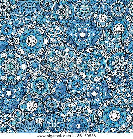 Repeating geometric tiles with mandala. Vector laced decorative background with floral and geometric ornament. Seamless oriental ornamental pattern. Indian or Arabic motive. Blue.
