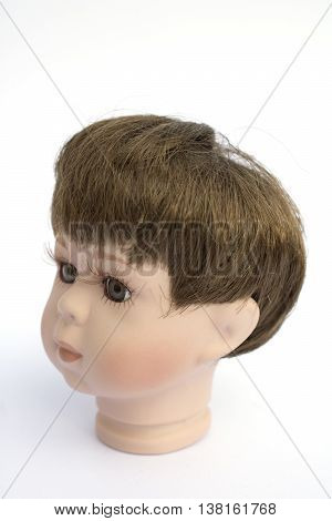 Little Boy Doll Head On White Background