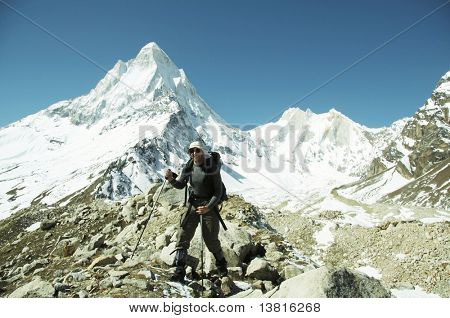 Hiker going along morane in Himalayan mountain