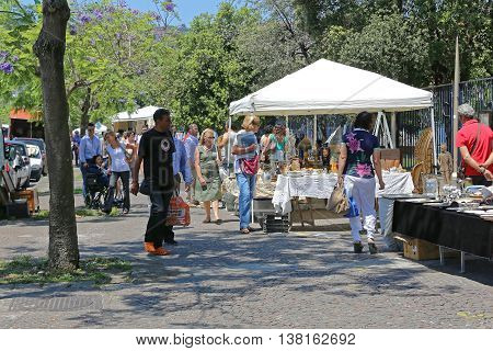 NAPLES ITALY - JUNE 22: Sunday Antique Market in Naples on JUNE 22 2014. People Browsing For Antiques at Seafront Promenade Lungomare in Napoli Italy.