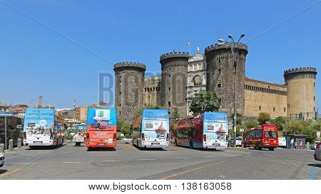 NAPLES ITALY - JUNE 22: Castel Nuovo in Naples on JUNE 22 2014. Sightseeing Tours Coach Buses in Front of The New Castle in Naples Italy.