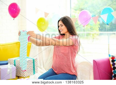 Pregnant woman with presents at baby shower party