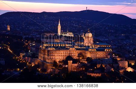 Buda castle night view, Harmashatarhegy Mountain in the background (Budapest, Hungary)