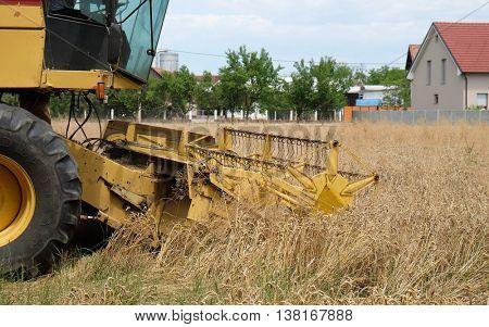 TRNOVEC, CROATIA - JULY 09, 2016: Combine harvester harvest ripe wheat on a farm in Trnovec, Croatia on July 09, 2016