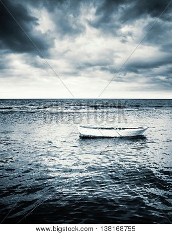 White Wooden Fishing Boat Under Stormy Clouds
