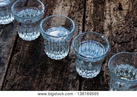 Shot Glasses Cold Vodka Top View On A Wooden Background