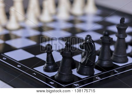 Chess Pieces Lining Up On Chess Board (focus On The Front Pieces)