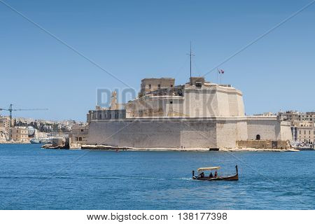 View of Fort Saint Angelo from Valletta Grand Harbour Birgu Malta Europe June 2016.